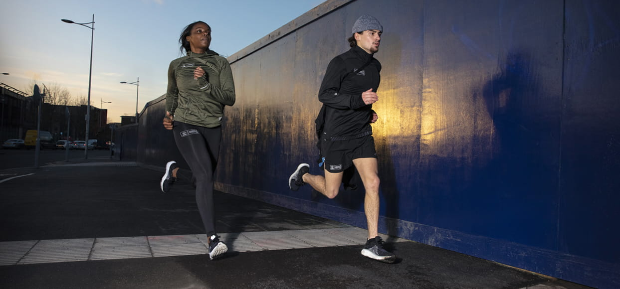 Runners running through London in New Balance kit