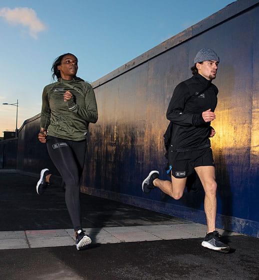 Two runners in official New Balance Virgin Money London Marathon training kit go for a run