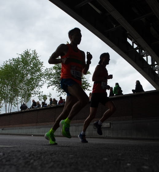 Runners running under Blackfriars bridge at the Virgin Money London Marathon