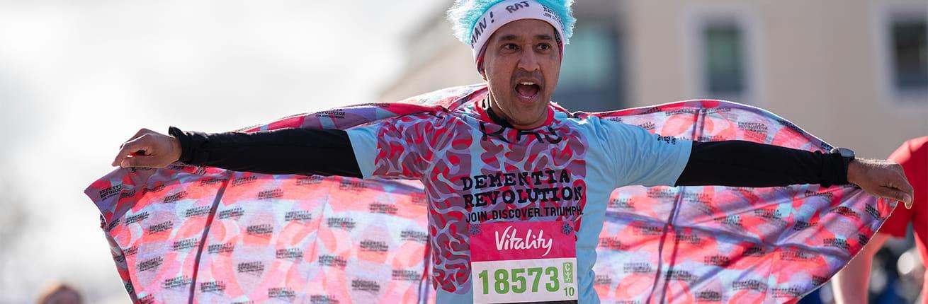 A Dementia Revolution runner crosses the 2020 Vitality Big Half Finish Line