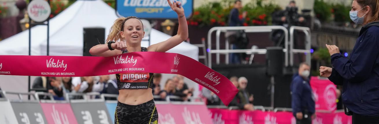 Charlotte Purdue crosses the finish line at the Vitality Big Half 2021